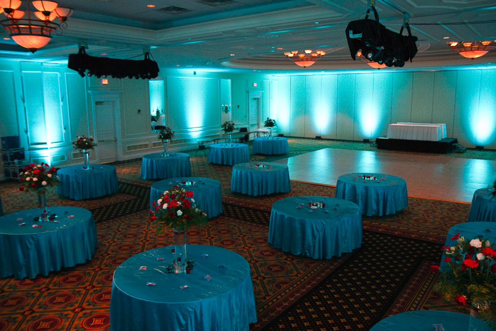 For this event the groom wanted the lighting color to match the tablecloths